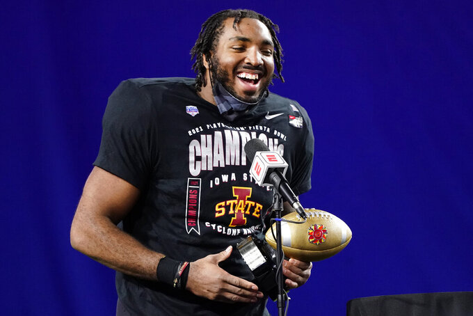 Iowa State linebacker O'Rien Vance holds the defensive player of the game award after the Fiesta Bowl NCAA college football game against Oregon, Saturday, Jan. 2, 2021, in Glendale, Ariz. Iowa State won 34-17. (AP Photo/Rick Scuteri)