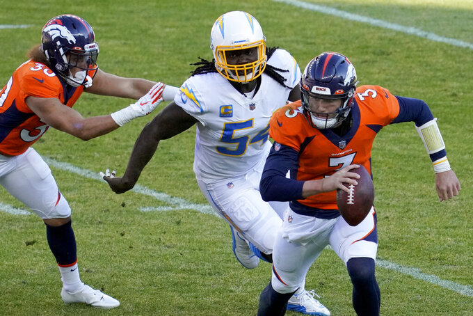 Los Angeles Chargers defensive end Melvin Ingram (54) chases down Denver Broncos quarterback Drew Lock (3) during the first half of an NFL football game, Sunday, Nov. 1, 2020, in Denver. (AP Photo/Jack Dempsey)