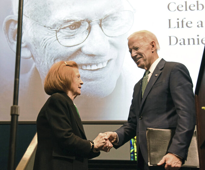 "In this March 2018 photo, Patricia Rooney shakes hands with former Vice President Joe Biden, the keynote speaker at ""Slainte! Celebrating the Life and Legacy of Dan Rooney"", at Duquesne University in Pittsburgh. Patricia Rooney, the wife of late Pittsburgh Steelers chairman Dan Rooney, has died. She was 88. The Steelers said in a statement that Patricia Rooney died peacefully at her home Saturday, Jan. 30, 2021. A cause of death was not given. (Darrell Sapp/Pittsburgh Post-Gazette via AP)"