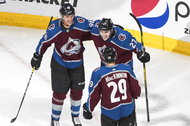 Colorado Avalanche's Mikko Rantanen (96), Ryan Graves (27) and Nathan MacKinnon (29) celebrate a goal against the St. Louis Blues during the third period of an NHL hockey playoff game Sunday, Aug. 2, 2020, in Edmonton, Alberta. (Jason Franson/The Canadian Press via AP)