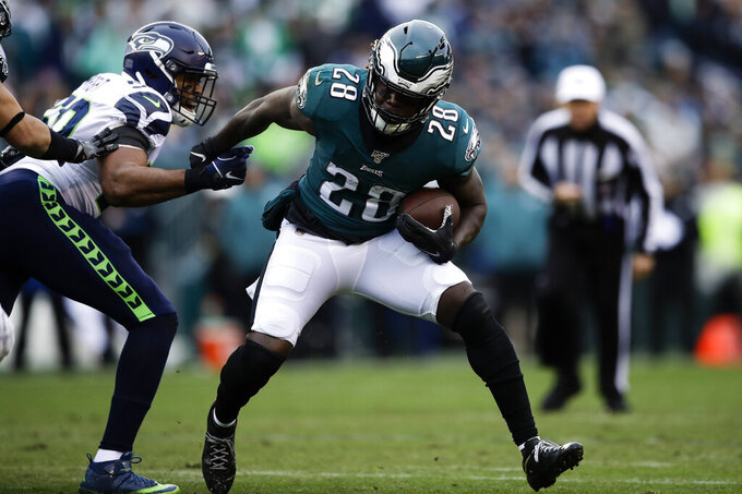 Philadelphia Eagles' Jay Ajayi runs past Seattle Seahawks' K.J. Wright during the first half of an NFL football game against the Seattle Seahawks, Sunday, Nov. 24, 2019, in Philadelphia. (AP Photo/Matt Rourke)