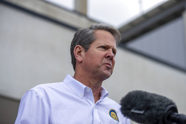 Governor Brian Kemp makes a statement and answers questions from the media following a tour of Fieldale Farms while visiting Gainesville, Friday, May 15, 2020. (Alyssa Pointer/Atlanta Journal-Constitution via AP)