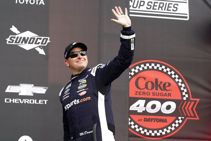 Michael McDowell waves to fans during driver introductions before the NASCAR Cup Series auto race at Daytona International Speedway, Saturday, Aug. 28, 2021, in Daytona Beach, Fla. (AP Photo/John Raoux)