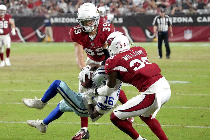Dallas Cowboys wide receiver Reggie Davis (16) pulls in a catch as Arizona Cardinals strong safety Shawn Williams (36) and cornerback Jace Whittaker (39) defend during the second half of an NFL preseason football game, Friday, Aug. 13, 2021, in Glendale, Ariz. (AP Photo/Rick Scuteri)