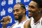 Los Angeles Clippers forward Kawhi Leonard, left, and guard Lou Williams attend the NBA basketball team's media day in Los Angeles, Sunday, Sept. 29, 2019. (AP Photo/Ringo H.W. Chiu)