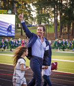 Actor and 1988 Longview High School graduate Matthew McConaughey takes the field with his children to deliver the commencement address at the school's graduation ceremony in Longview, Texas, on Friday, May 17, 2019. McConaughey has finally received his high school diploma, more than 30 years after graduating. (Les Hassell/The News-Journal via AP)