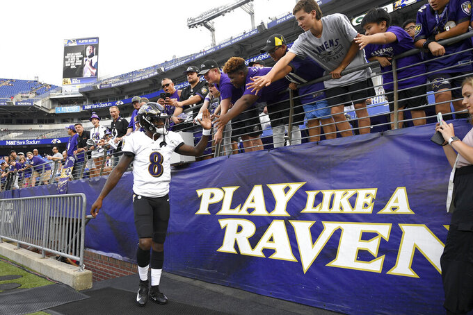 Baltimore Ravens quarterback Lamar Jackson takes the field prior to a NFL football preseason game against the Green Bay Packers, Thursday, Aug. 15, 2019, in Baltimore. (AP Photo/Nick Wass)