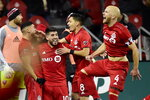 Toronto FC midfielder Jonathan Osorio (21) celebrates his goal in extra time against D.C. United during an MLS soccer Eastern Conference first-round playoff match in Toronto on Saturday, Oct. 19, 2019. (Frank Gunn/The Canadian Press via AP)