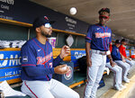 Minnesota Twins' Gilberto Celestino, left, practices juggling under the watch of Nick Gordon before the team's baseball game against the Detroit Tigers on Sunday, July 18, 2021, in Detroit. (AP Photo/Duane Burleson)