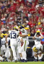Michigan's Jake Moody (13) celebrates with holder J.J. McCarthy after kicking a field goal against Nebraska during the first half of an NCAA college football game Saturday, Oct. 9, 2021, at Memorial Stadium in Lincoln, Neb. (AP Photo/Rebecca S. Gratz)