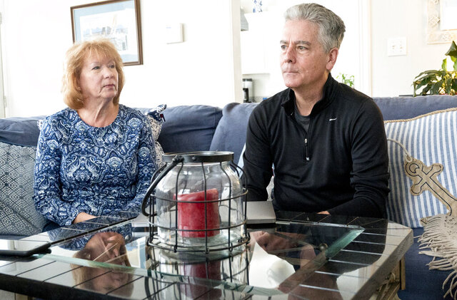 This photo taking Feb. 2, 2020, shows Jill and Frank Larkin, a former Sergeant of Arms at the U.S. Senate, talking about their son Ryan Larkin, a decorated Navy SEAL who committed suicide after suffering from undiagnosed Traumatic Brain Injury.  (Joshua McKerrow/The Baltimore Sun via AP)