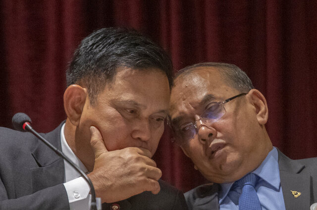 Spokesperson of the Office of the Attorney General Prayuth Bejraguna, left, talks to Director General of Department of Thonburi Criminal Litigation Poramate Intarachumnum during a press conference in Bangkok, Thailand, Tuesday, Aug, 4, 2020. An Attorney General special committee suggested that the charge of causing death by reckless driving against Vorayuth
