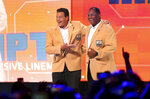 In this Friday, June 7, 2019 photo, Chicago Bears Hall of Famers Dan Hampton and Richard Dent have a laugh on stage during the Bears100 Celebration Weekend at the Donald E. Stephens Convention Center in Rosemont, Ill. (Chris Sweda/Chicago Tribune via AP)