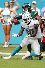 Miami Dolphins wide receiver Preston Williams (18) misses the ball after a call of pass interference by New York Jets cornerback Darryl Roberts (27) during the second half of an NFL football game, Sunday, Nov. 3, 2019, in Miami Gardens, Fla. (AP Photo/Wilfredo Lee)