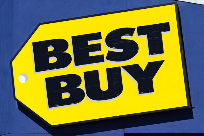 A sign for a Best Buy store is displayed Friday, Feb. 26, 2021, in Salem, N.H. Best Buy Co. is raising a key sales annual forecast after the nation's largest consumer electronics chain posted better-than expected first-quarter results boosted by stimulus payments and continued nesting at the home.  (AP Photo/Charles Krupa)