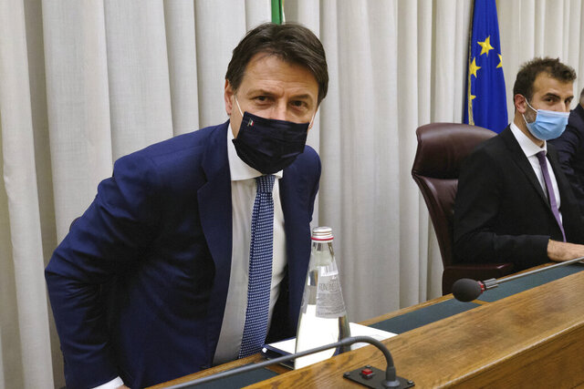 Italian Premier Giuseppe Conte, left, is flanked by Erasmo Palazzotto, President of a Parliamentary investigative commission on the slain of Giulio Regeni, at the Senate in Rome, Thursday, June 18, 2020. Italian Premier Giuseppe Conte was heard by a Parliamentary investigative commission on the slain of Italian researcher Giulio Regeni who was murdered in Cairo in 2016. Giulio Regeni, 28, an Italian doctoral student disappeared in Cairo on Jan. 25, the anniversary of Egypt's 2011 uprising, a day when security forces were on high alert and on the streets in force to prevent any demonstrations or protests. His body, stabbed repeatedly and exhibiting cigarette burns and other signs of torture, was reported found on Feb. 3. (Mauro Scrobogna/LaPresse via AP)