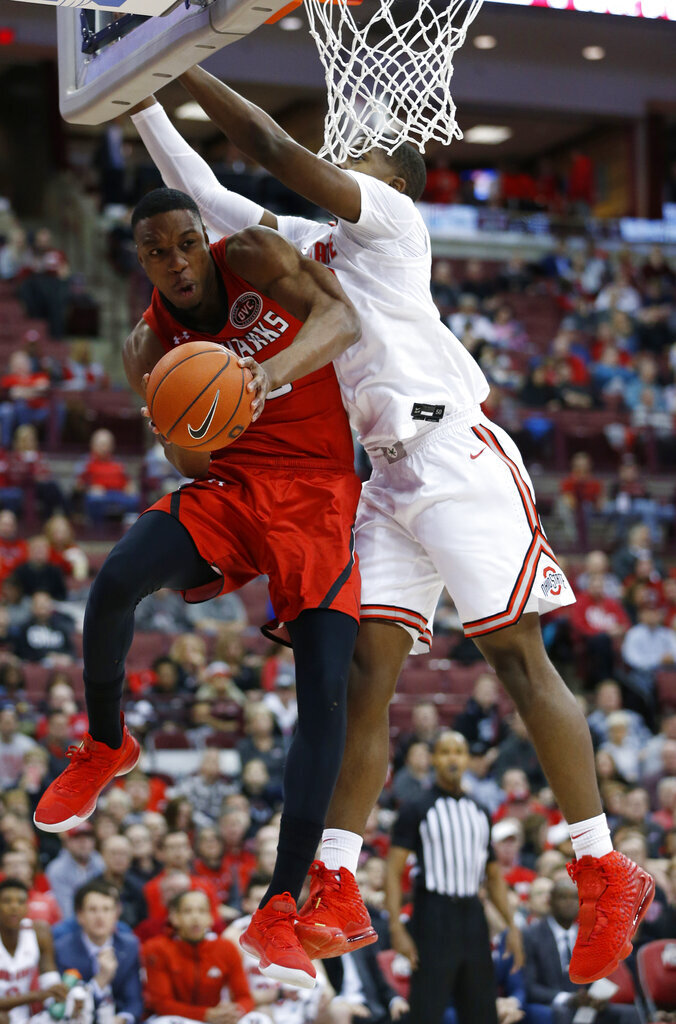Southeast Missouri State's Quatarrius Wilson, left, passes the ball underneath the basket as Ohio State's E.J. Liddell defends during the first half of an NCAA college basketball game, Tuesday, Dec. 17, 2019, in Columbus, Ohio. (AP Photo/Jay LaPrete)