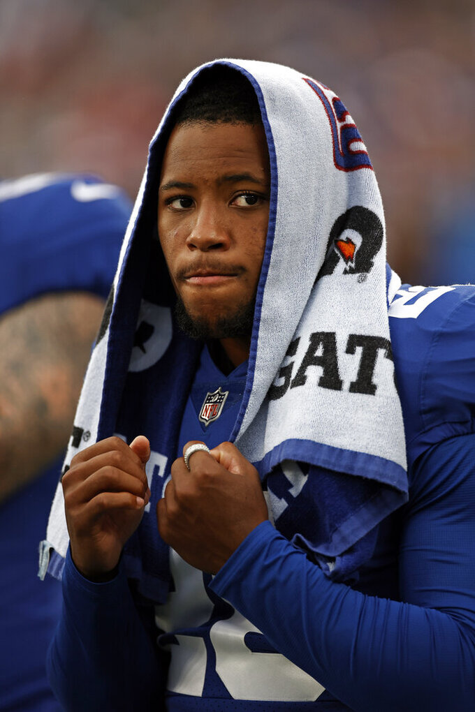 FILE - In this Sunday, Aug. 29, 2021, file photo, New York Giants running back Saquon Barkley looks on from the sideline during an NFL preseason football game against the New England Patriots in East Rutherford, N.J. While the Giants are once again going to be without star running back Barkley and playmaking receivers Kenny Golladay and Kadarius Toney, the offense is expected to get back wide out Darius Slayton. (AP Photo/Adam Hunger, File)