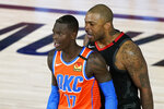 Houston Rockets' P.J. Tucker, right, yells as Oklahoma City Thunder's Dennis Schroder (17) after a foul during the second half of an NBA basketball first round playoff game Saturday, Aug. 29, 2020, in Lake Buena Vista, Fla. Both players were ejected. (AP Photo/Ashley Landis)