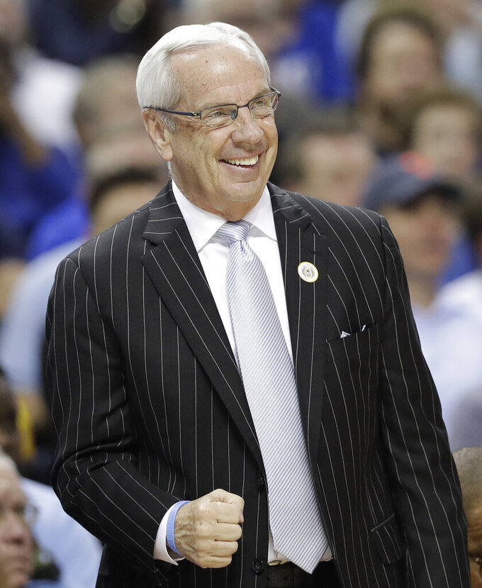 North Carolina head coach Roy Williams pumps his fist after a play against Duke during the first half of an NCAA college basketball game in the Atlantic Coast Conference tournament in Charlotte, N.C., Friday, March 15, 2019. (AP Photo/Chuck Burton)