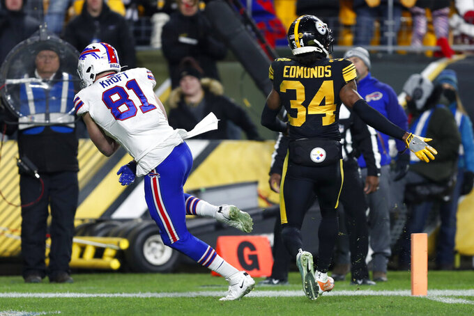 Buffalo Bills tight end Tyler Kroft (81) scores on a pass from quarterback Josh Allen, running near Pittsburgh Steelers strong safety Terrell Edmunds (34), during the second half of an NFL football game in Pittsburgh, Sunday, Dec. 15, 2019. (AP Photo/Keith Srakocic)
