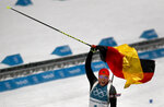Laura Dahlmeier, of Germany, waves the German flag as she crosses the finish line to win the gold medal in the women's 10-kilometer biathlon pursuit at the 2018 Winter Olympics in Pyeongchang, South Korea, Monday, Feb. 12, 2018. (AP Photo/Charlie Riedel)