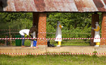 In this photo taken Saturday, May 12, 2018, health workers are sprayed with chlorine after leaving the isolation ward to diagnose and treat suspected Ebola patients, at Bikoro Hospital in Bikoro, the rural area where the Ebola outbreak was announced last week, in Congo. Congo's latest Ebola outbreak has now spread to Mbandaka, a city of more than 1 million people, a worrying shift as the deadly virus risks traveling more easily in densely populated areas. (Mark Naftalin/UNICEF via AP)
