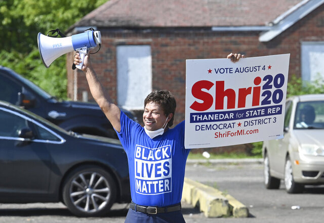 State Representative candidate Shri Thanedar uses a bull horn at 7 Mile Road and Mound Road for reach voters on July 24, 2020.  Thanedar who spent millions on an unsuccessful run for governor appears likely to get to the Capitol in another way.  Shri Thanedar was in first place in the Democratic primary for a seat in the House, with 98% of precincts reporting in the 3rd District.  (Max Ortiz/Detroit News via AP)