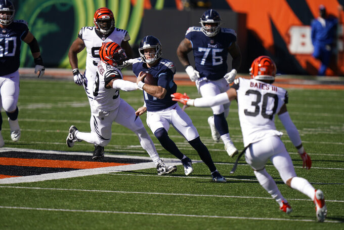 Tennessee Titans quarterback Ryan Tannehill (17) runs during the first half of an NFL football game against the Cincinnati Bengals, Sunday, Nov. 1, 2020, in Cincinnati. (AP Photo/Bryan Woolston)