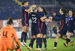 United States players run to celebrate with Kristie Mewis, number 22, who scored her side's second goal during the international friendly women's soccer match between The Netherlands and the US at the Rat Verlegh stadium in Breda, southern Netherlands, Friday Nov. 27, 2020. (Piroschka van de Wouw/Pool via AP)