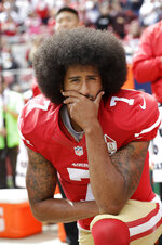 FILE - In this Oct. 2, 2016, file photo, then-San Francisco 49ers quarterback Colin Kaepernick kneels during the national anthem before an NFL football game against the Dallas Cowboys, in Santa Clara, Calif. Because Kaepernick was the first to kneel during the anthem to bring attention to social causes, the NFL has always been at the epicenter of the debate. League policy at the time was murky on whether players were required to stand. (AP Photo/Marcio Jose Sanchez, File)