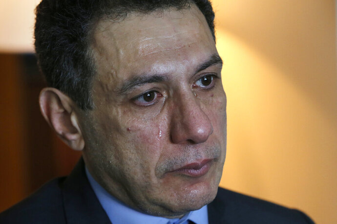 Nizar Zakka a Lebanese citizen and permanent U.S. resident who was released in Tehran after nearly four years in jail on charges of spying, cries during an interview with The Associated Press at a hotel in Dbayeh, north of Beirut, Lebanon, Wednesday, June 12, 2019. Zakka, an information technology expert, who was detained in Iran in September 2015 while trying to fly out of Tehran called on President Donald Trump to