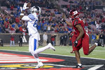 FILE - In this Nov. 24, 2018, file photo, Kentucky wide receiver Josh Ali (82) catches a touchdown pass during the team's NCAA college football game against Louisville in Louisville, Ky. The Southeastern Conference's conference-only scheduling decision during the coronavirus pandemic wiped out any hopes of saving four in-state rivalries against Atlantic Coast Conference opponents, all traditionally played on the final Saturday of the regular season. (AP Photo/Bryan Woolston, File)