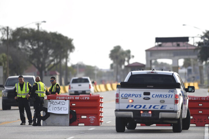 The entrances to the Naval Air Station-Corpus Christi are closed following an active shooter threat, Thursday, May 21, 2020, in Corpus Christi, Texas. Naval Air Station-Corpus Christi says the shooter was