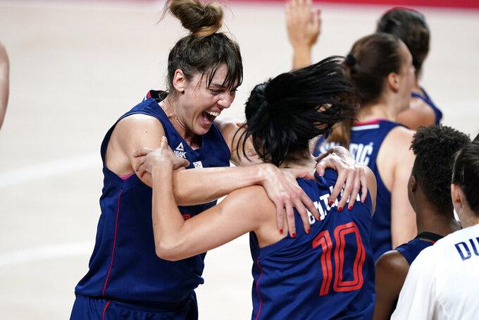 Serbia's Tina Krajisnik celebrates with teammate Dajana Butulija (10) at the end of a women's basketball quarterfinal round game against China at the 2020 Summer Olympics, Wednesday, Aug. 4, 2021, in Saitama, Japan. (AP Photo/Charlie Neibergall)