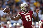Boston College quarterback Anthony Brown (13) passes during the first half of an NCAA college football game against Virginia Tech in Boston, Saturday, Aug. 31, 2019. (AP Photo/Michael Dwyer)
