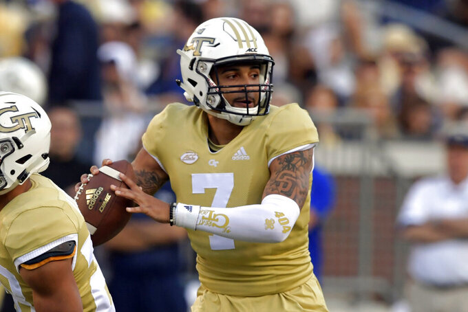 FILE - In this April 26, 2019, file photo, Georgia Tech quarterback Lucas Johnson (7) prepares to pass during Georgia Tech's NCAA college spring football game in Atlanta. Johnson is expected to be the starter, even though he's never thrown a pass at the college level. (Hyosub Shin/Atlanta Journal-Constitution via AP, File)