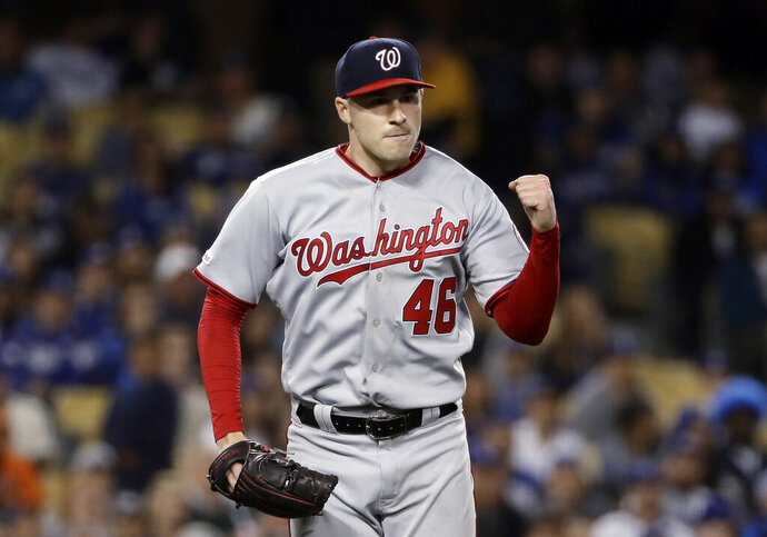 Washington Nationals starting pitcher Patrick Corbin reacts after getting Los Angeles Dodgers' Austin Barnes to ground into an inning-ending double pay during the seventh inning of a baseball game Thursday, May 9, 2019, in Los Angeles. (AP Photo/Marcio Jose Sanchez)