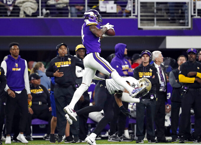FILE - In this Jan. 14, 2018, file photo, Minnesota Vikings wide receiver Stefon Diggs (14) makes a catch over New Orleans Saints free safety Marcus Williams (43) on his way to the game winning touchdown during the second half of an NFL divisional football playoff game in Minneapolis. This Sunday's wild-card round meeting between Minnesota and New Orleans in the Superdome will be the third playoff meeting in the past decade between the teams. (AP Photo/Jeff Roberson, File)