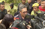 In this image from a video, Negeri Sembilan state police chief Mohamad Mat Yusop, center, speaks to media in Pantai, Malaysia Tuesday, Aug. 13, 2019. Malaysian rescuers on Tuesday found the body of a Caucasian female in the forest surrounding a nature resort where a 15-year-old London girl was reported missing more than a week ago, police said. The state police chief said officials were in the process of determining whether the body is Nora Anne Quoirin, who was discovered missing by her family from the Dusun eco-resort in the southern state on Aug. 4. (AP Photo)