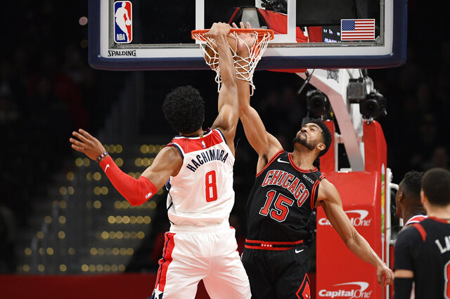 Washington Wizards forward Rui Hachimura (8), of Japan, dunks against Chicago Bulls forward Chandler Hutchison (15) during the first half of an NBA basketball game, Tuesday, Feb. 11, 2020, in Washington. The Wizards won 126-114. (AP Photo/Nick Wass)
