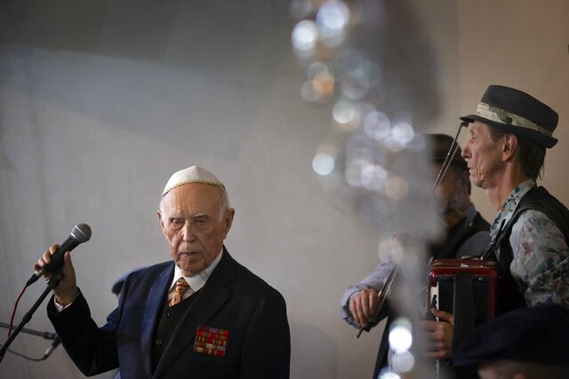 Holocaust survivor and WWII veteran Mikhail Spectr, 86, pauses as he speaks during the annual Hanukkah Menorah Lighting Ceremony in Moscow, Russia, Sunday, Dec. 22, 2019. Spectr was taken to Jewry in 1941 at the age of 8 when Nazi soldiers arrived at his village in Ukraine Soviet republic. Mikhail Spectr had been kept at ghetto in Transnistria, territory between Dniester and Southern Bug, occupied by the Nazi and its allies from 1941 and 1944. (AP Photo/Alexander Zemlianichenko)