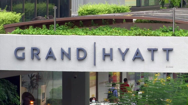 This image made from video shows the exterior of the Grand Hyatt hotel in Singapore, Monday, Feb. 10, 2020. A middle-aged businessman from southern England unwittingly carried the new virus across two continents and unwittingly infected at least 11 people in three countries, in just one example that illustrates how China's outbreak could turn into a global pandemic amid fast-moving international travel. The businessman contracted the virus while attending a gas industry conference in the Grand Hyatt in Singapore in January. (AP Photo)
