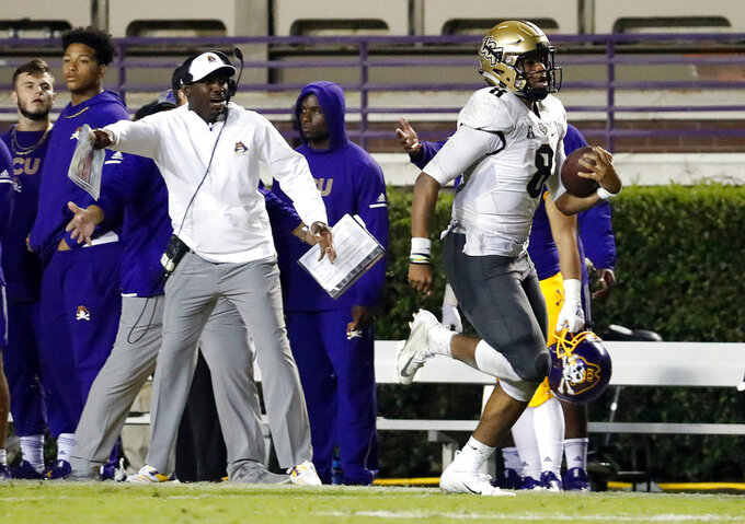 Central Florida's Darriel Mack Jr. (8) runs the ball against East Carolina during the second half of an NCAA college football game in Greenville, N.C., Saturday, Oct. 20, 2018. UCF won 37-10. (AP Photo/Karl B DeBlaker)