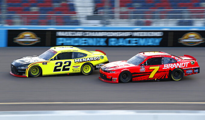 Austin Cindric (22) and Justin Allgaier (7) race for the lead through Turn 4 during a NASCAR Xfinity Series auto race at Phoenix Raceway, Saturday, Nov. 7, 2020, in Avondale, Ariz. (AP Photo/Ralph Freso)