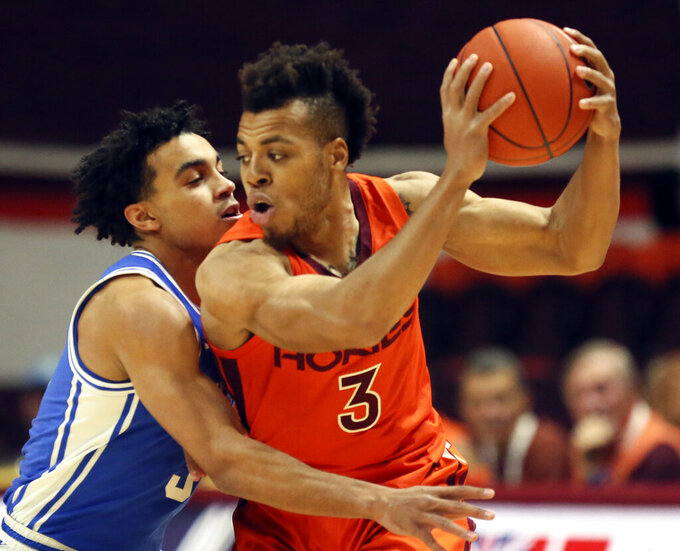 Virginia Tech's Wabissa Bede (3) is guarded by Duke's Tre Jones (3) during the first half during an NCAA college basketball game Friday, Dec. 6, 2019, in Blacksburg, Va. (Matt Gentry/The Roanoke Times via AP)