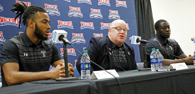Temple interim football coach Ed Foley, center, discusses the strengths of their opponents, Duke, while wide receiver Ventell Bryant, left, and defensive tackle Michael Dogbe, right, listen, at the 2018 Independence Bowl news conference in Shreveport, La., Wednesday, Dec. 26, 2018. Temple faces Duke in the NCAA college football game Thursday. (Rogelio V. Solis/AP)