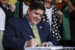 Gov. J. B. Pritzker signs a bill that legalizes adult-use cannabis in the state of Illinois at Sankofa Cultural Arts and Business Center in Chicago. Illinois becomes the 11th to legalize the adult-use of recreational marijuana, Tuesday, June 25, 2019. (AP Photo/Amr Alfiky)