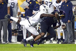 West Virginia cornerback Nicktroy Fortune (11) breaks up fourth and one pass to TCU wide receiver Al'Dontre Davis (80) near the end of the fourth quarter in an NCAA college football game Friday, Nov. 29, 2019, in Fort Worth, Texas. (AP Photo/Richard W. Rodriguez)