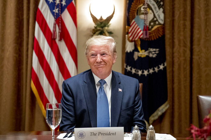 President Donald Trump smiles during a luncheon with members of the United Nations Security Council in the Cabinet Room at the White House in Washington, Thursday, Dec. 5, 2019. (AP Photo/Andrew Harnik)